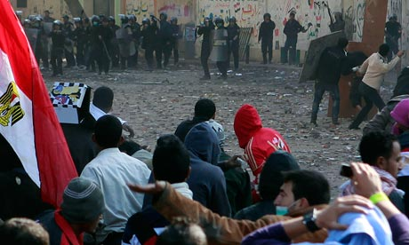Protesters confront police  near Tahrir Square in Cairo