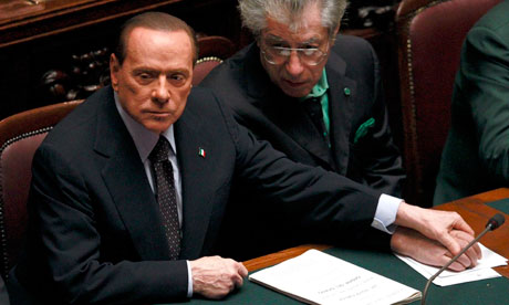 Silvio Berlusconi holds Northern League leader Umberto Bossi's hand in parliament
