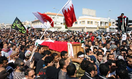 Bahraini Shiite protesters carry the coffin of a an anti-government protester