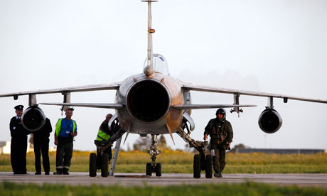 Libyan airforce pilot walks next to his Mirage F1 fighter jet after landing in Malta