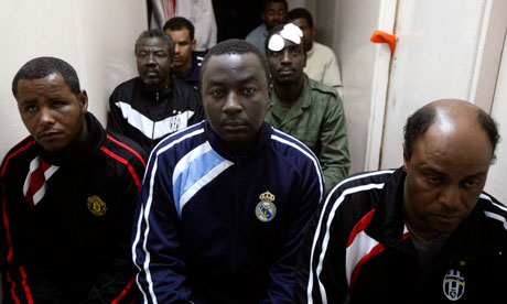 Suspected African mercenaries sit in a court in Benghazi