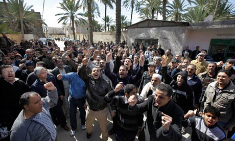 mourners at a funeral of an anti-government protester in Tripoli