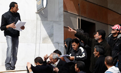 People queue for a government cash handout in Tripoli, Libya