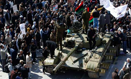 A Libyan army tank is surrounded by protesters in the city of Zawiya