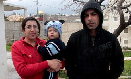 Ahmed Hamdallah, 33, his wife Amany and their son Yazan, 1 at their home in East Jerusalem