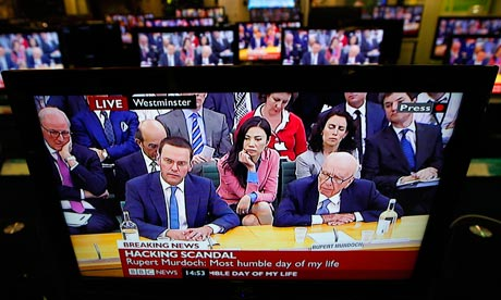 James Murdoch and Rupert Murdoch appear on television as they are questioned