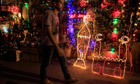 A man walks past shops selling festive lights for the holy month of Ramadan, in old Cairo