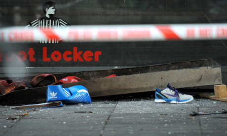 Debris outside a Foot Locker store in Brixton after it was broken into by looters