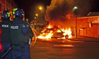 A car burns during riots in St Pauls, Bristol