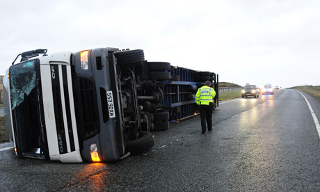 A lorry lies on its side after being blown over in high winds on the A66 in County Durham