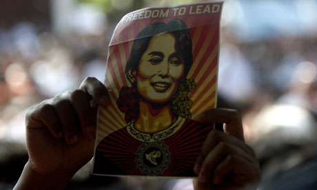 An Aung San Suu Kyi supporter holds
