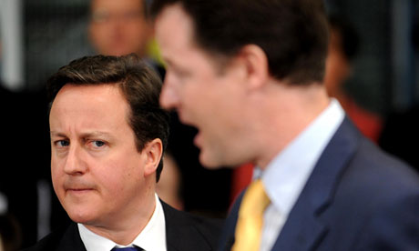 Deputy Prime Minister Nick Clegg answers questions as Prime Minister David Cameron looks on