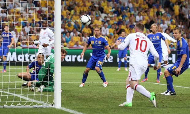 Andriy Pyatov watches Rooney head the ball into an open goal
