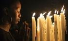 Local resident Thandeka Mncwango prays for Nelson Mandela