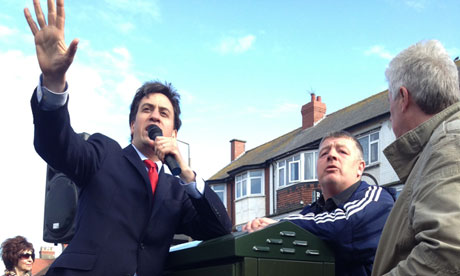 Ed Miliband in conversation with an unemployed man in Cleveleys, Lancs, on 29 April 2013