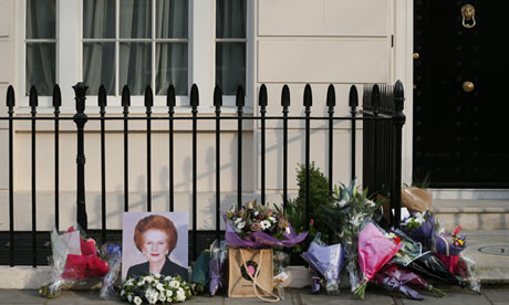 A portrait of Margaret Thatcher outside her residence in Chester Square, London