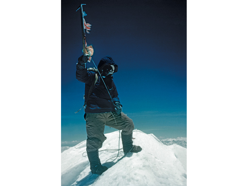 Tenzing Norgay stands on the summit of Mount Everest