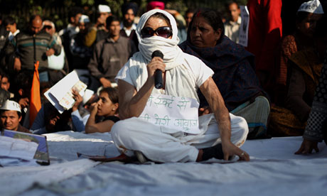 An acid attack victim tells her story at a protest against rape in New Delhi