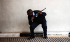 An armed offical stands guard at the Westgate shopping mall after a shootout in Nairobi, Kenya