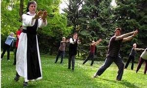 Nuns performing Chi Gong exercises in the grounds of their abbey