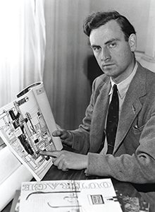 Ian Nairn pictured in the 1950s holding a copy of the Architectural Review.