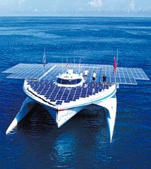 The MS Tranor PlanetSolar passes Bora Bora in a Pacific on a excursion around a world