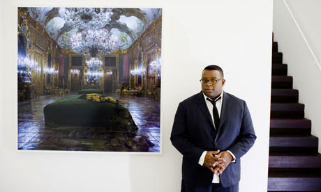 Issac Julien in front of one of his works