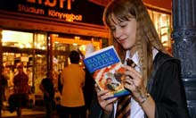 Hungarian girl reads Harry Potter book