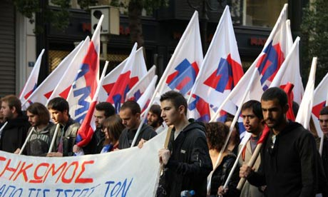 Member of the PAME union demonstrate outside the Greek parliament
