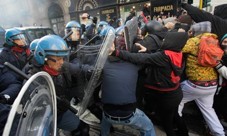 Students clash with police during a demonstration in Milan, Italy, Thursday, 17 November 2011