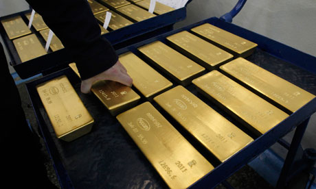 A worker stores marked ingots of 99.99 percent pure gold at the Krastsvetmet plant in Russia
