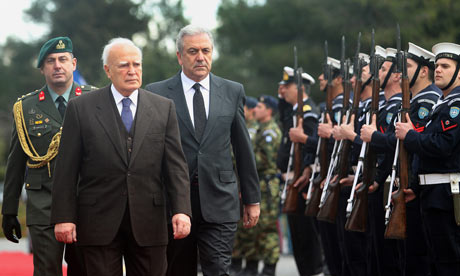 Greek president Karolos Papoulias (2L) with defence minister Dimitris Avramopoulos(3L). 15 Feb 2012.