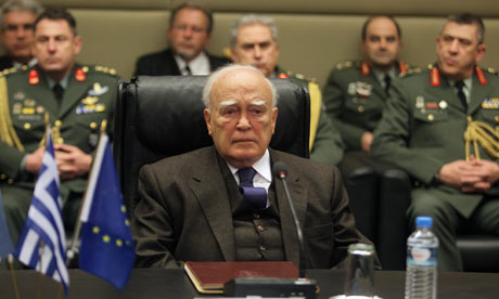 Greek president Karolos Papoulias (C) sitting among military leadership in Greece, 15 February 2012.