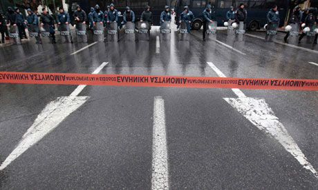 Police officers secure a street during an anti-austerity rally by pensioners in Athens