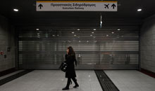 A woman in front of a closed suburban railway station during a 24-hour strike in Athens February 7.