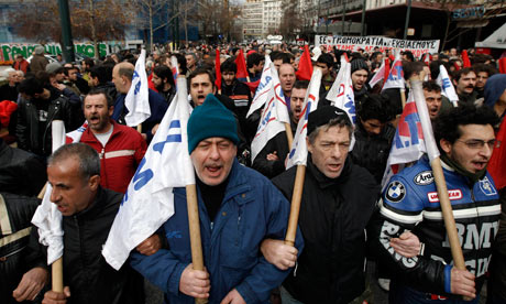 Communist-affiliated union PAME march against new austerity measures in Athens on February 7, 2012.