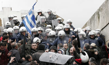 Protesters holding Greek flag clash with riot police.
