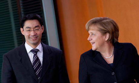 Angela Merkel and Philipp Roesler arrive at a cabinet meeting in Berlin, February 8, 2012.