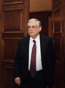 Greek prime minister Lucas Papademos enters the meeting room at Maximos mansion on Feb 8, 2012.
