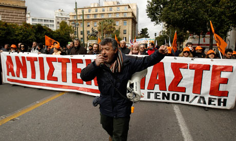 Members of Greece's public power corporation workers union march in Athens on February 9, 2012.
