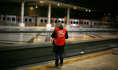A worker, part of a picket line, at the Rossio railway terminal ahead of general strike in Portugal.