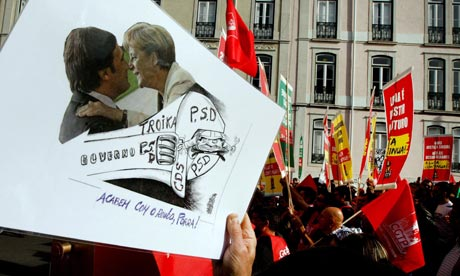 Strikers carry banners in Lisbon as a general strike takes place in Portugal.