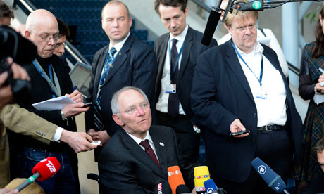 German finance minister Wolfgang Schauble (C) talks during the Ecofin meeting, March 30, 2012