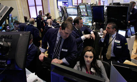 Traders work in their booth on the floor of the New York Stock Exchange.