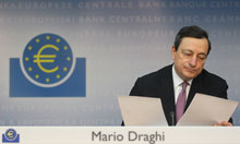 ECB President Draghi checks papers during the monthly news conference in Frankfurt