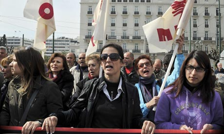 Wives of striking Greek metal workers protest outside the Greek parliament in Athens.
