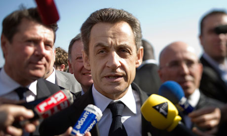 Nicolas Sarkozy (C) speaks to journalists in the French southeastern city of Nice, on March 9, 2012