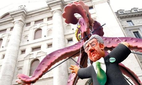 A puppet of Italian Prime Minister Monti is hung in front of Milan's stock exchange.