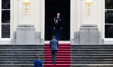 Dutch Prime Minister Mark Rutte arrives at the Royal palace to meet Queen Beatrix.