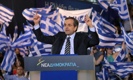 New Democracy (ND) party leader Antonis Samaras greets supporters during a rally in Heraklion, Crete